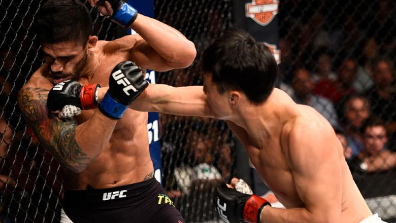 LAS VEGAS, NV - JULY 08:  (R-L) Doo Ho Choi of South Korea knocks down Thiago Tavares of Brazil with a punch in their featherweight bout during The Ultimate Fighter Finale event at MGM Grand Garden Arena on July 8, 2016 in Las Vegas, Nevada.  (Photo by Je