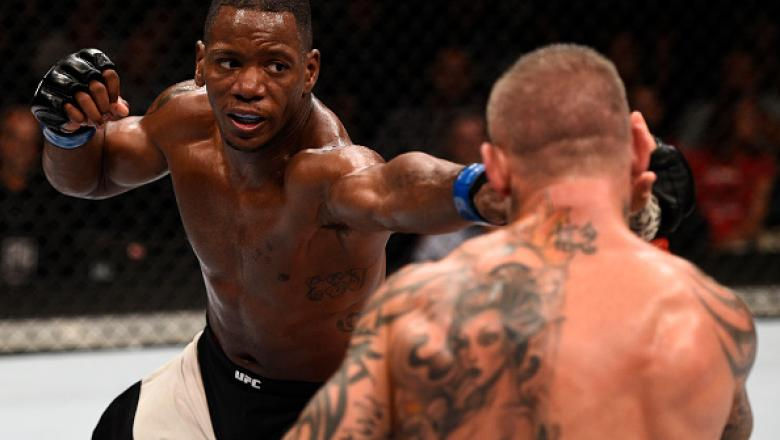 LAS VEGAS, NV - JULY 08:  (L-R) Will Brooks punches Ross Pearson of England in their lightweight bout during The Ultimate Fighter Finale event at MGM Grand Garden Arena on July 8, 2016 in Las Vegas, Nevada.  (Photo by Jeff Bottari/Zuffa LLC/Zuffa LLC via