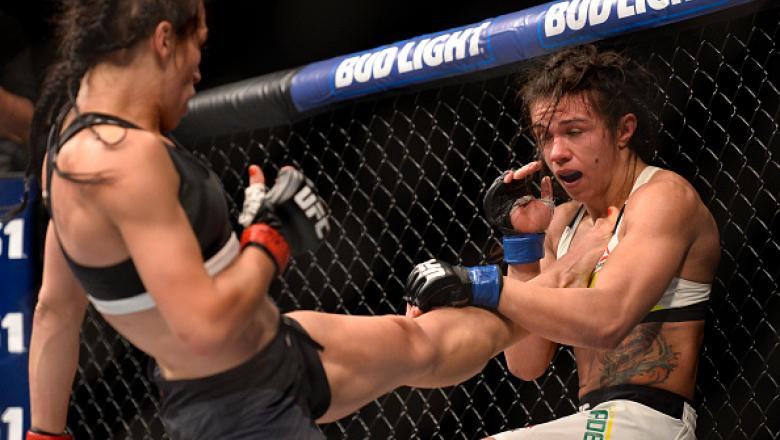 LAS VEGAS, NV - JULY 08:  (L-R) Joanna Jedrzejczyk of Poland kicks Claudia Gadelha of Brazil in their women's strawweight championship bout during The Ultimate Fighter Finale event at MGM Grand Garden Arena on July 8, 2016 in Las Vegas, Nevada.  (Photo by