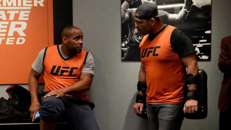 LAS VEGAS, NV - FEBRUARY 06:  Daniel Cormier (L) and Cain Valesquez interact backstage during the filming of The Ultimate Fighter: Undefeated on February 6, 2017 in Las Vegas, Nevada. (Photo by Brandon Magnus/Zuffa LLC/Zuffa LLC via Getty Images)