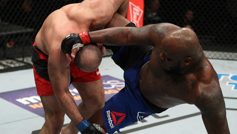 ALBANY, NY - DECEMBER 09:  (R-L) Shamil Abdurakhimov of Russia takes down Derrick Lewis in their heavyweight bout during the UFC Fight Night event at the Times Union Center on December 9, 2016 in Albany, New York. (Photo by Patrick Smith/Zuffa LLC/Zuffa L