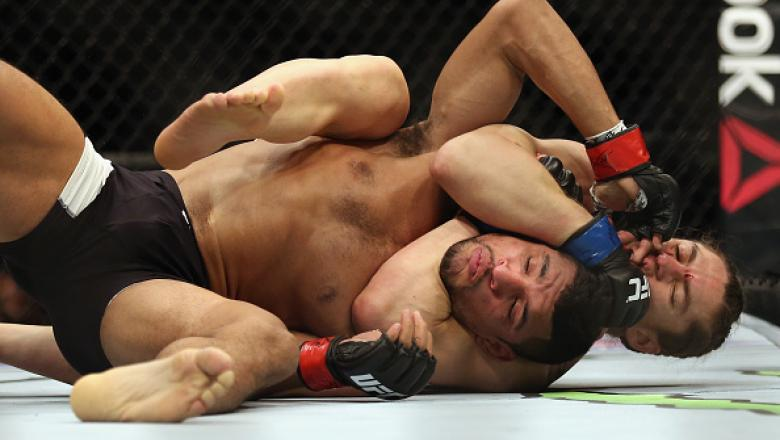 BOSTON, MA - JANUARY 17:  Luke Sanders chokes Maximo Blanco in their featherweight bout during UFC Fight Night 81 at TD Banknorth Garden on January 17, 2016 in Boston, Massachusetts.  (Photo by Tim Bradbury/Getty Images)