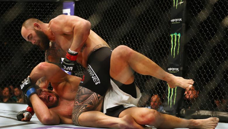 BOSTON, MA - JANUARY 17:  Travis Browne (top) grapples with Matt Mitrione in their heavyweight bout during UFC Fight Night 81 at TD Banknorth Garden on January 17, 2016 in Boston, Massachusetts.  (Photo by Maddie Meyer/Getty Images)
