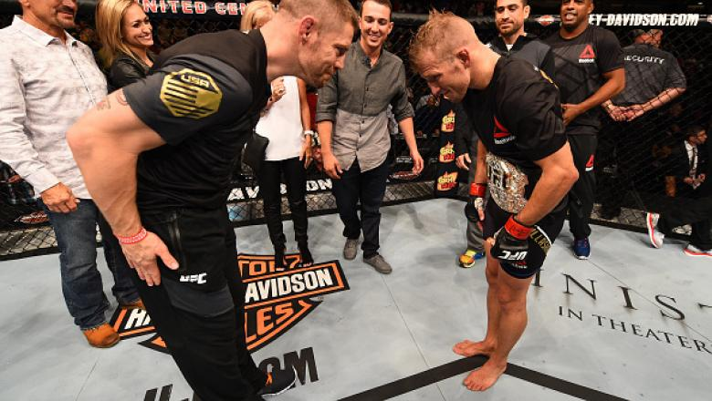 CHICAGO, IL - JULY 25:   TJ Dillashaw (R) is congratulated by coach Duane Ludwig after his TKO victory over Renan Barao of Brazil in their UFC bantamweight championship bout during the UFC event at the United Center on July 25, 2015 in Chicago, Illinois.