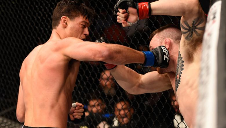 BRISBANE, AUSTRALIA - MARCH 20:  (L-R) Alan Jouban of the United States punches Brendan O'Reilly of Australia in their welterweight bout during the UFC Fight Night event at the Brisbane Entertainment Centre on March 20, 2016 in Brisbane, Australia. (Photo