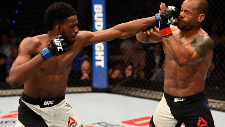 BRISBANE, AUSTRALIA - MARCH 20:  (L-R) Neil Magny of the United States punches Hector Lombard of Cuba in their welterweight bout during the UFC Fight Night event at the Brisbane Entertainment Centre on March 20, 2016 in Brisbane, Australia. (Photo by Josh