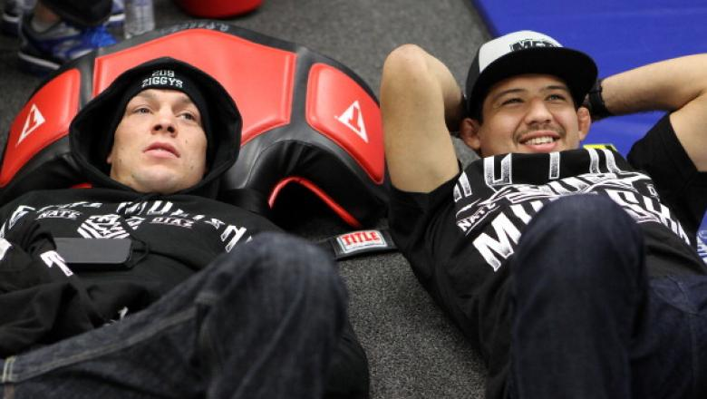 SEATTLE, WA - DECEMBER 08:  Nate Diaz (L) relaxes in his locker room with teammate Gilbert Melendez before his bout against Benson Henderson at the UFC on FOX event on December 8, 2012  at Key Arena in Seattle, Washington.  (Photo by Mike Roach/Zuffa LLC/