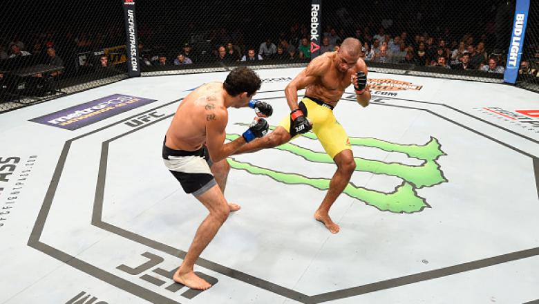 CHICAGO, IL - JULY 23:  (R-L) Edson Barboza of Brazil kicks the leg of Gilbert Melendez in their lightweight bout during the UFC Fight Night event at the United Center on July 23, 2016 in Chicago, Illinois. (Photo by Josh Hedges/Zuffa LLC/Zuffa LLC via Ge