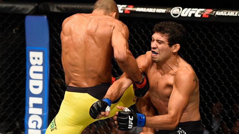CHICAGO, IL - JULY 23: (L-R) Edson Barboza of Brazil lands a flying knee to the body of Gilbert Melendez in their lightweight bout during the UFC Fight Night event at the United Center on July 23, 2016 in Chicago, Illinois. (Photo by Josh Hedges/Zuffa LLC