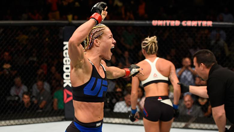 CHICAGO, IL - JULY 23: (L-R) Felice Herrig celebrates after defeating Kailin Curran by submission in their women's strawweight bout during the UFC Fight Night event at the United Center on July 23, 2016 in Chicago, Illinois. (Photo by Josh Hedges/Zuffa LL