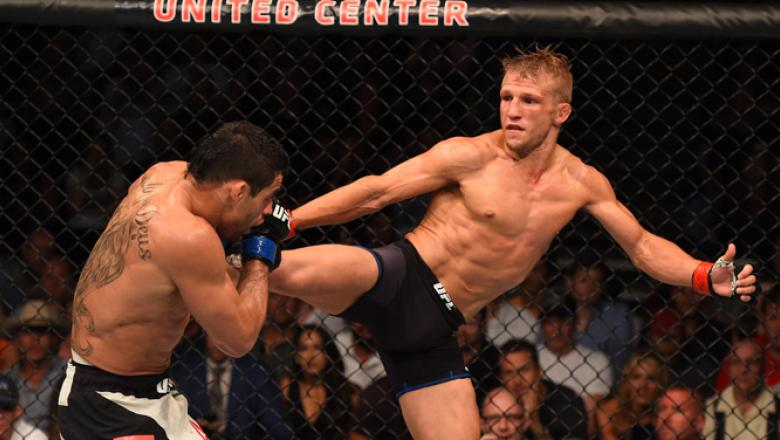 CHICAGO, IL - JULY 25:   (R-L) TJ Dillashaw kicks Renan Barao of Brazil in their UFC bantamweight championship bout during the UFC event at the United Center on July 25, 2015 in Chicago, Illinois. (Photo by Jeff Bottari/Zuffa LLC/Zuffa LLC via Getty Image