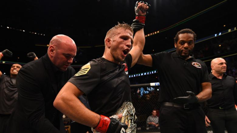 CHICAGO, IL - JULY 25:   TJ Dillashaw celebrates after his TKO victory over Renan Barao of Brazil UFC bantamweight championship bout during the UFC event at the United Center on July 25, 2015 in Chicago, Illinois. (Photo by Jeff Bottari/Zuffa LLC/Zuffa LL