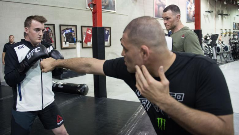 LAS VEGAS, NV - MARCH 09:   Ty Dillon, driver of the #13 GEICO Chevrolet in the Monster Energy NASCAR Cup Series trains with Cain Velasquez during the UFC/NASCAR Cross-Training event at the TUF Gym on March 9, 2017 in Las Vegas, Nevada. (Photo by Brandon