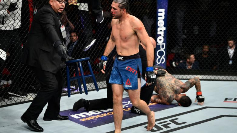 FRESNO, CA - DECEMBER 09:  (L-R) Brian Ortega celebrates his submission victory over Cub Swanson in their featherweight bout during the UFC Fight Night event inside Save Mart Center on December 9, 2017 in Fresno, California. (Photo by Jeff Bottari/Zuffa L
