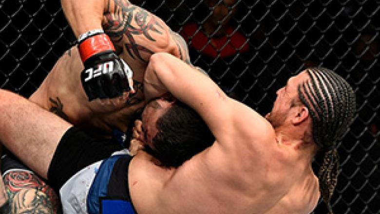 FRESNO, CA - DECEMBER 09:  (R-L) Brian Ortega attempts to submit Cub Swanson in their featherweight bout during the UFC Fight Night event inside Save Mart Center on December 9, 2017 in Fresno, California. (Photo by Jeff Bottari/Zuffa LLC/Zuffa LLC via Get