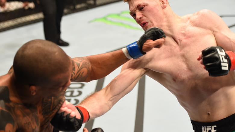 GLASGOW, SCOTLAND - JULY 18:  (R-L) Joe Duffy of Ireland punches Ivan Jorge of Brazil in their lightweight fight during the UFC Fight Night event inside the SSE Hydro on July 18, 2015 in Glasgow, Scotland.  (Photo by Josh Hedges/Zuffa LLC/Zuffa LLC via Ge
