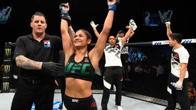 GLASGOW, SCOTLAND - JULY 16:  Cynthia Calvillo celebrates her victory over Joanne Calderwood of Scotland in their women's strawweight bout during the UFC Fight Night event at the SSE Hydro Arena Glasgow on July 16, 2017 in Glasgow, Scotland. (Photo by Jos