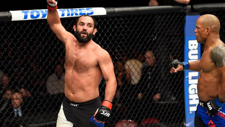 HALIFAX, NS - FEBRUARY 19:  (L-R) Johny Hendricks celebrates after going three rounds against Hector Lombard of Cuba in their middleweight fight during the UFC Fight Night event inside the Scotiabank Centre on February 19, 2017 in Halifax, Nova Scotia, Ca