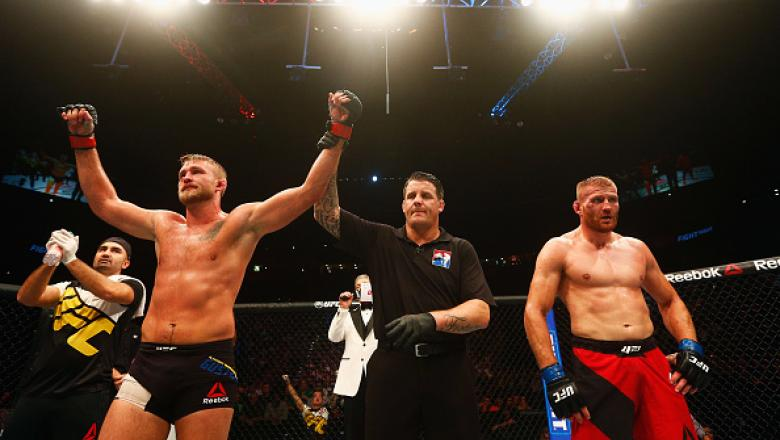 HAMBURG, GERMANY - SEPTEMBER 03:  Alexander Gustafsson (L) of Sweden celebrates his victory over Jan Blachowicz (R) of Poland in their Light Heavyweight Bout during the UFC Fight Night held at Barclaycard Arena on September 3, 2016 in Hamburg, Germany.  (