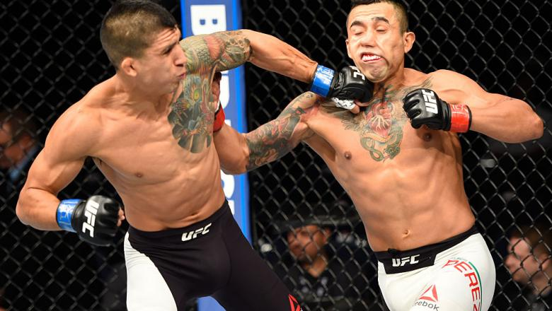 HIDALGO, TX - SEPTEMBER 17:   (L-R) Albert Morales punches Alejandro Perez of Mexico in their bantamweight bout during the UFC Fight Night event at State Farm Arena on September 17, 2016 in Hidalgo, Texas. (Photo by Josh Hedges/Zuffa LLC/Zuffa LLC via Get