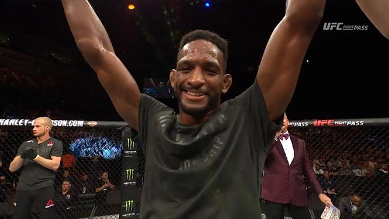 Neil Magny celebrates after a victory over Craig White at Fight Night Liverpool