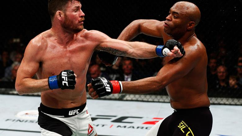 LONDON, ENGLAND - FEBRUARY 27:  Anderson 'The Spider' Silva of Brazil (R) and Michael 'The Count' Bisping of England (L) compete in their Middleweight bout during the UFC Fight Night held at at Indigo at The O2 Arena on February 27, 2016 in London, Englan