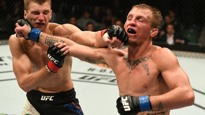 MELBOURNE, AUSTRALIA - NOVEMBER 27:   (L-R) Dan Hooker of New Zealand and Jason Knight trade punches in their featherweight bout during the UFC Fight Night event at Rod Laver Arena on November 27, 2016 in Melbourne, Australia. (Photo by Jeff Bottari/Zuffa