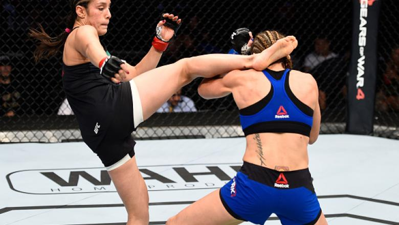 MEXICO CITY, MEXICO - NOVEMBER 05:  (L-R) Alexa Grasso of Mexico kicks Heather Jo Clark of the United States in their women's strawweight bout during the UFC Fight Night event at Arena Ciudad de Mexico on November 5, 2016 in Mexico City, Mexico. (Photo by
