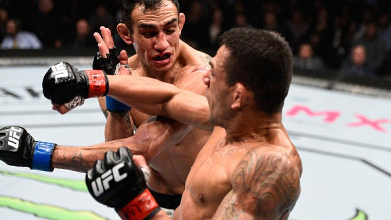 MEXICO CITY, MEXICO - NOVEMBER 05:  (L-R) Tony Ferguson of the United States exchanges punches with Rafael Dos Anjos of Brazil in their lightweight bout during the UFC Fight Night event at Arena Ciudad de Mexico on November 5, 2016 in Mexico City, Mexico.