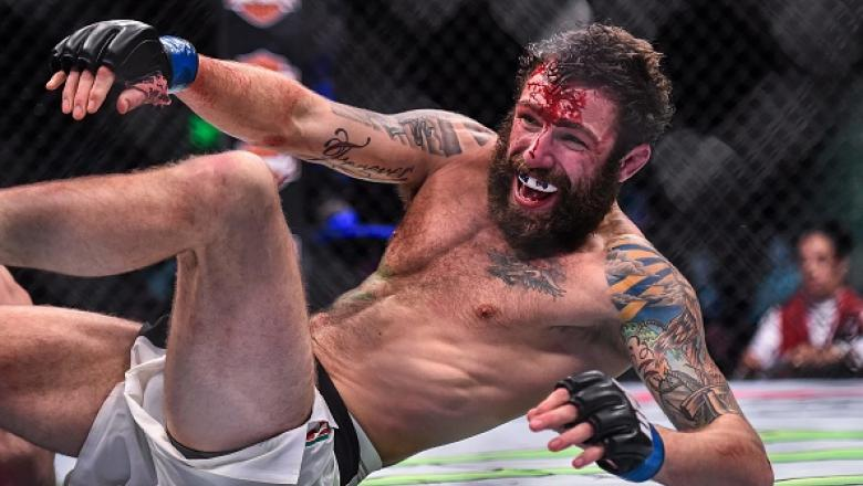 10 December 2015; Michael Chiesa celebrates his victory over Jim Miller in their lightweight bout. UFC Fight Night: VanZant v Namajunas, The Chelsea at The Cosmopolitan, Las Vegas, USA. Picture credit: Ramsey Cardy / SPORTSFILE (Photo by Sportsfile/Corbis