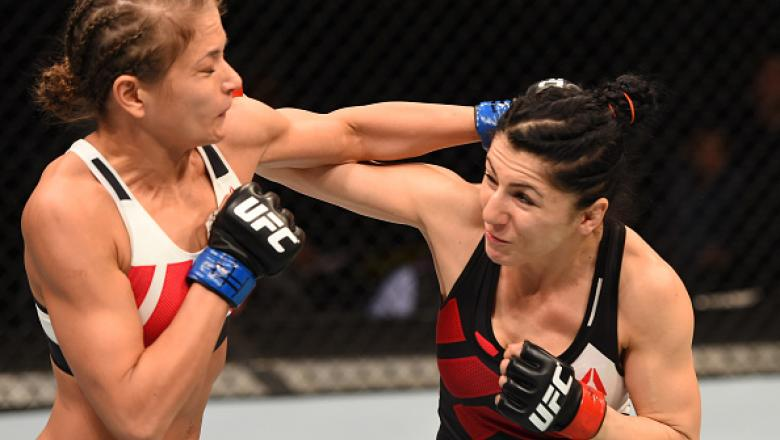 ORLANDO, FL - DECEMBER 19:   (R-L) Randa Markos punches Karolina Kowalkiewicz in their women's strawweight bout during the UFC Fight Night event at the Amway Center on December 19, 2015 in Orlando, Florida. (Photo by Josh Hedges/Zuffa LLC/Zuffa LLC via Ge