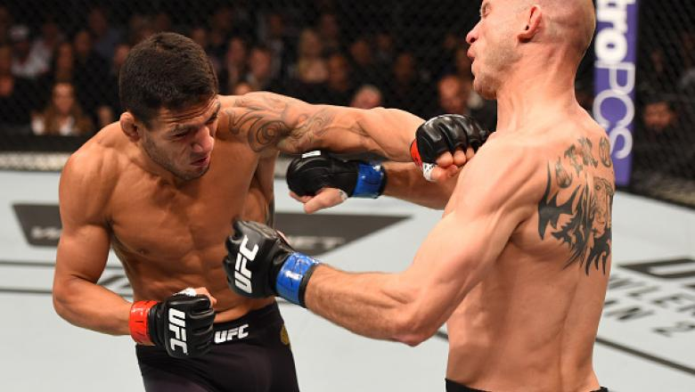 ORLANDO, FL - DECEMBER 19:   (L-R) Rafael dos Anjos punches Donald Cerrone in their UFC lightweight title bout during the UFC Fight Night event at the Amway Center on December 19, 2015 in Orlando, Florida. (Photo by Josh Hedges/Zuffa LLC/Zuffa LLC via Get