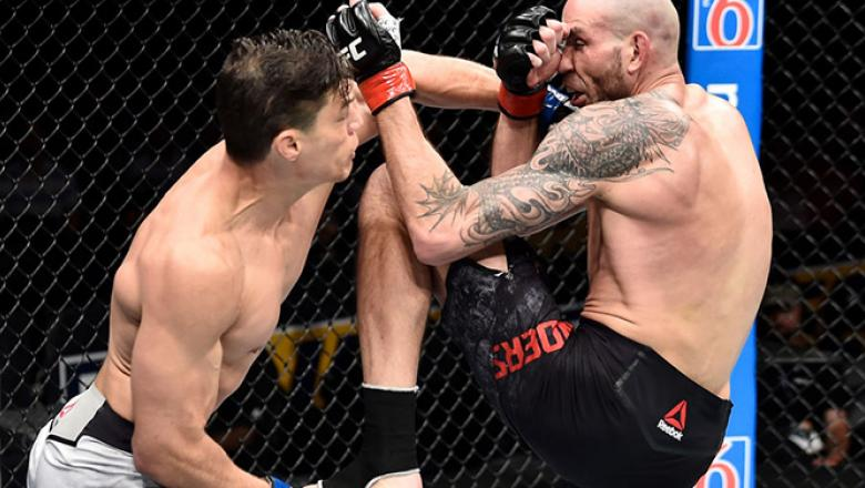 ORLANDO, FL - FEBRUARY 24:  (L-R) Alan Jouban punches Ben Saunders in their welterweight bout during the UFC Fight Night event at Amway Center on February 24, 2018 in Orlando, Florida.  (Photo by Jeff Bottari/Zuffa LLC/Zuffa LLC via Getty Images)