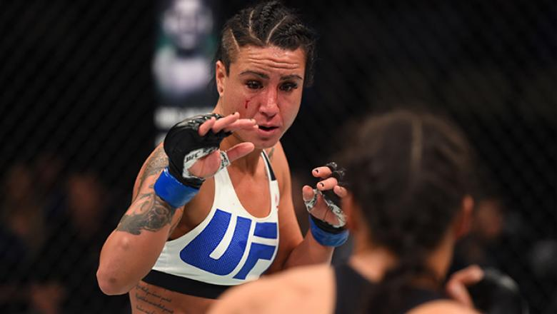 PITTSBURGH, PA - FEBRUARY 21: (L-R) Ashlee Evans-Smith circles Marion Reneau in their women's bantamweight bout during the UFC Fight Night event at Consol Energy Center on February 21, 2016 in Pittsburgh, Pennsylvania. (Photo by Jeff Bottari/Zuffa LLC/Zuf