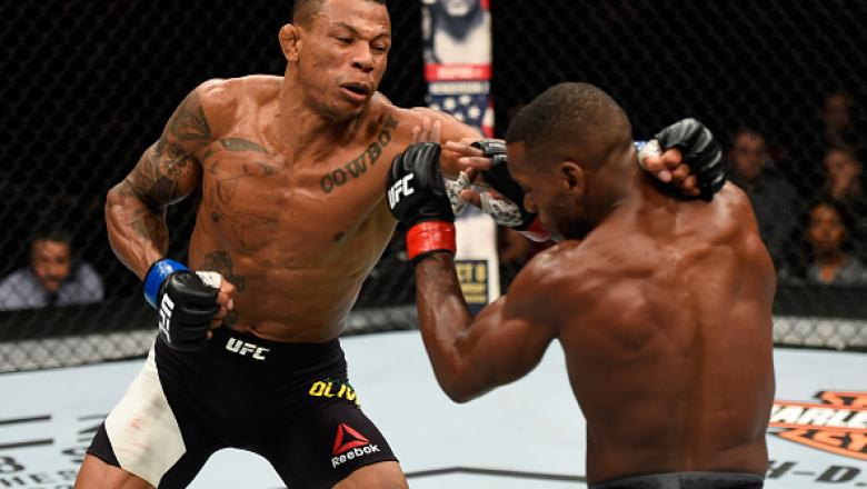 PORTLAND, OR - OCTOBER 01:  (L-R) Alex Oliveira of Brazil punches Will Brooks in their lightweight bout during the UFC Fight Night event at the Moda Center on October 1, 2016 in Portland, Oregon. (Photo by Josh Hedges/Zuffa LLC/Zuffa LLC via Getty Images)