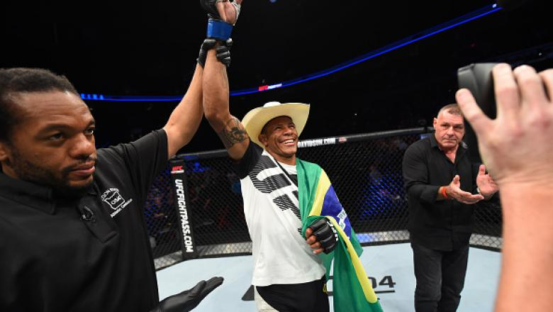 PORTLAND, OR - OCTOBER 01:  Alex Oliveira of Brazil celebrates after defeating Will Brooks in their lightweight bout during the UFC Fight Night event at the Moda Center on October 1, 2016 in Portland, Oregon. (Photo by Josh Hedges/Zuffa LLC/Zuffa LLC via