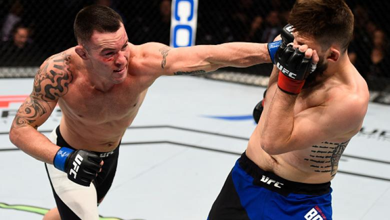 SACRAMENTO, CA - DECEMBER 17:  (L-R) Colby Covington punches Bryan Barberena in their welterweight bout during the UFC Fight Night event inside the Golden 1 Center Arena on December 17, 2016 in Sacramento, California. (Photo by Jeff Bottari/Zuffa LLC/Zuff