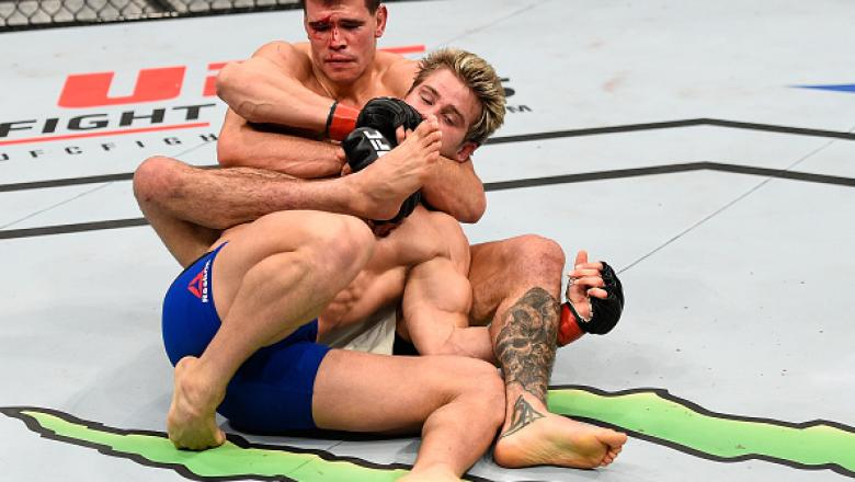 SACRAMENTO, CA - DECEMBER 17:  (L-R) Mickey Gall attempts to secure a rear choke submission against Sage Northcutt in their welterweight bout during the UFC Fight Night event inside the Golden 1 Center Arena on December 17, 2016 in Sacramento, California.