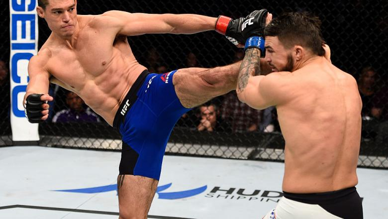 SACRAMENTO, CA - DECEMBER 17:  (L-R) Alan Jouban kicks Mike Perry in their welterweight bout during the UFC Fight Night event inside the Golden 1 Center Arena on December 17, 2016 in Sacramento, California. (Photo by Jeff Bottari/Zuffa LLC/Zuffa LLC via G