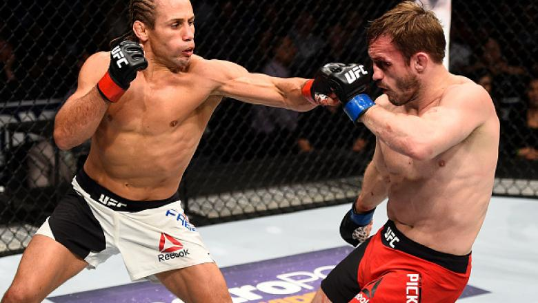SACRAMENTO, CA - DECEMBER 17:  (L-R) Urijah Faber punches Brad Pickett of England in their bantamweight bout during the UFC Fight Night event inside the Golden 1 Center Arena on December 17, 2016 in Sacramento, California. (Photo by Jeff Bottari/Zuffa LLC