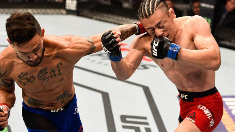 SALT LAKE CITY, UT - AUGUST 06:  (L-R) Cub Swanson punches Tatsuya Kawajiri of Japan in their featherweight bout during the UFC Fight Night event at Vivint Smart Home Arena on August 6, 2016 in Salt Lake City, Utah. (Photo by Jeff Bottari/Zuffa LLC/Zuffa