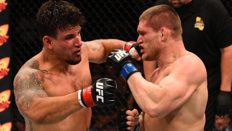 SAN DIEGO, CA - JULY 15:   (L-R) Frank Mir punches Todd Duffee in their heavyweight bout during the UFC event at the Valley View Casino Center on July 15, 2015 in San Diego, California. (Photo by Jeff Bottari/Zuffa LLC/Zuffa LLC via Getty Images)