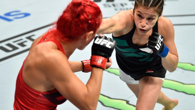 MEXICO CITY, MEXICO - AUGUST 05:  (R-L) Alexa Grasso of Mexico punches Randa Markos of Iraq in their women's strawweight bout during the UFC Fight Night event at Arena Ciudad de Mexico on August 5, 2017 in Mexico City, Mexico. (Photo by Jeff Bottari/Zuffa