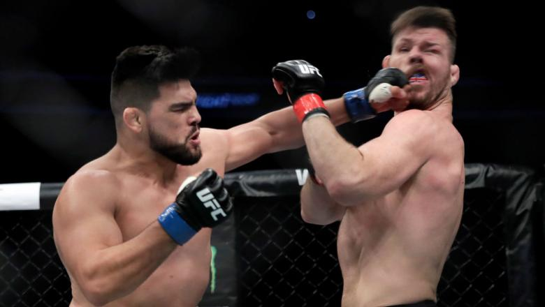 SHANGHAI, CHINA - NOVEMBER 25: (L-R) Kelvin Gastelum fights with Michael Bisping during the UFC Fight Night at Mercedes-Benz Arena on November 25, 2017 in Shanghai, China.  (Photo by Hu Chengwei/Getty Images)