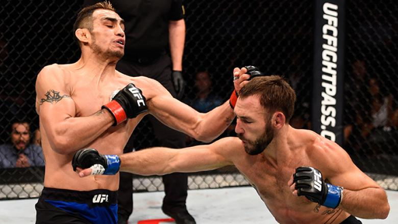 JULY 13: (L-R) Tony Ferguson punches Lando Vannat in their lightweight bout during the UFC Fight Night event on July 13, 2016 at Denny Sanford Premier Center in Sioux Falls, South Dakota. (Photo by Jeff Bottari/Zuffa LLC/Zuffa LLC via Getty Images)