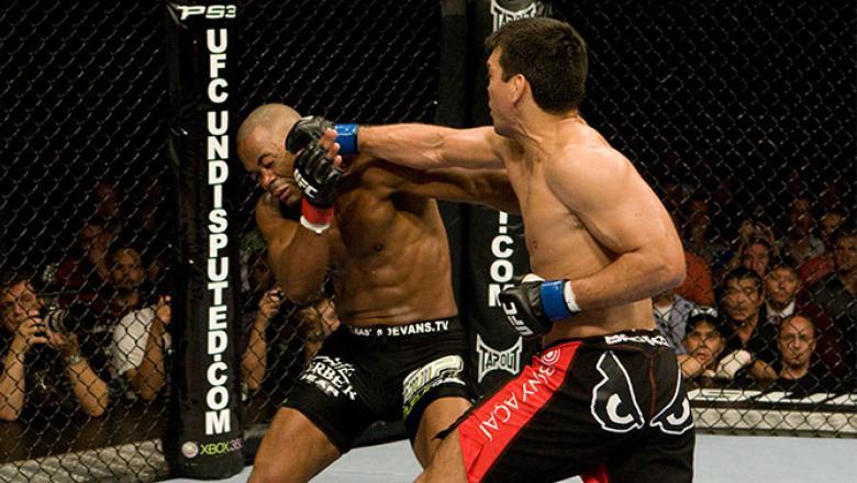 LAS VEGAS - MAY 23:  Lyoto Machida (black/red shorts) def. Rashad Evans (black tight shorts) - KO 3:57 round 2 during UFC 98 at MGM Grand Arena on May 23, 2009 in Las Vegas, Nevada.  (Photo by Josh Hedges/Zuffa LLC via Getty Images)