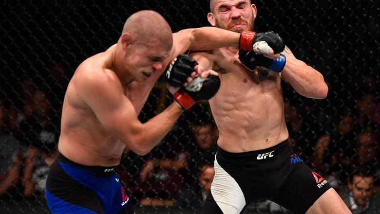 VANCOUVER, BC - AUGUST 27:  (R-L) Jim Miller of the United States exchanges punches with Joe Lauzon of the United States in their lightweight bout during the UFC Fight Night event at Rogers Arena on August 27, 2016 in Vancouver, British Columbia, Canada.