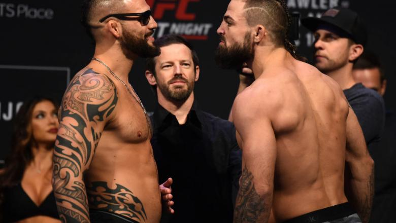 WINNIPEG, CANADA - DECEMBER 15:  (L-R) Santiago Ponzinibbio of Argentina and Mike Perry face off during the UFC Fight Night weigh-in on December 15, 2017 in Winnipeg, Canada. (Photo by Josh Hedges/Zuffa LLC/Zuffa LLC via Getty Images)