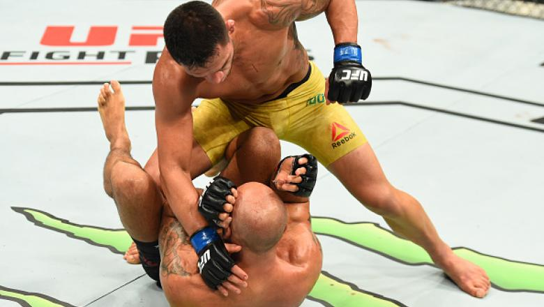 WINNIPEG, CANADA - DECEMBER 16:  (R-L) Rafael Dos Anjos of Brazil punches Robbie Lawler in their welterweight bout during the UFC Fight Night event at Bell MTS Place on December 16, 2017 in Winnipeg, Manitoba, Canada. (Photo by Josh Hedges/Zuffa LLC/Zuffa