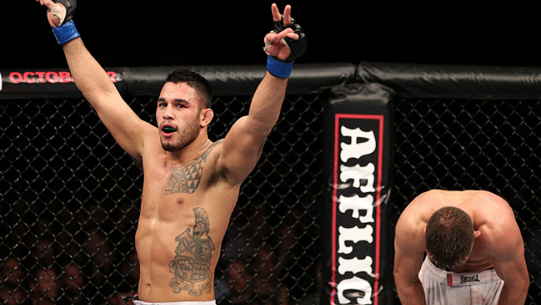 NOTTINGHAM, ENGLAND - SEPTEMBER 29:  Brad Tavares (L) and Tom Watson react after their three-round battle at the UFC on Fuel TV event at Capital FM Arena on September 29, 2012 in Nottingham, England.  (Photo by Josh Hedges/Zuffa LLC/Zuffa LLC via Getty Im